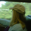 """Carole looks out the window and wonders what the day will bring as we ride the train from Beverly to Boston  (This is before the Engineer """"misses"""" Swampscott and we have to back-up)"""