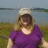 Carole at Georges Island in Boston Harbor with the City well behind her