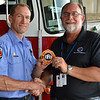 LCC President Tim Hetzner presents a patch from the Davenport (Iowa) Fire Department to the Prescott Fire Department, home to the Granite Mountain Hotshots