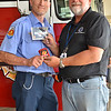 LCC President Tim Hetzner presents a patch from the Belvidere (Illinois) Fire Department to the Prescott Fire Department, home to the Granite Mountain Hotshots