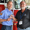 LCC President Tim Hetzner presents a patch from the Elgin (Illinois) Fire Department to the Prescott Fire Department, home to the Granite Mountain Hotshots