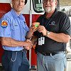 LCC President Tim Hetzner presents a patch from the Elmhurst (Illinois) Fire Department to the Prescott Fire Department, home to the Granite Mountain Hotshots