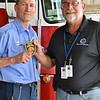 LCC President Tim Hetzner presents a patch from the East Dundee (Illinois) Fire Department to the Prescott Fire Department, home to the Granite Mountain Hotshots