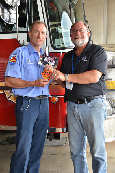 LCC President Tim Hetzner presents a patch from the Lake Zurich (Illinois) Fire Department to the Prescott Fire Department, home to the Granite Mountain Hotshots