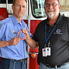 LCC President Tim Hetzner presents a patch from the West Dundee (Illinois) Fire Department to the Prescott Fire Department, home to the Granite Mountain Hotshots