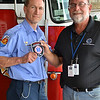 LCC President Tim Hetzner presents a patch from the Elgin (Illinois) Fire Department - Paramedics to the Prescott Fire Department, home to the Granite Mountain Hotshots