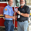 LCC President Tim Hetzner presents a patch from the Carpentersville (Illinois) Fire Department to the Prescott Fire Department, home to the Granite Mountain Hotshots