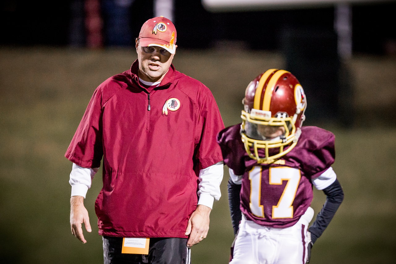 Coach Lynn instructs Jack about the kick-off strategy