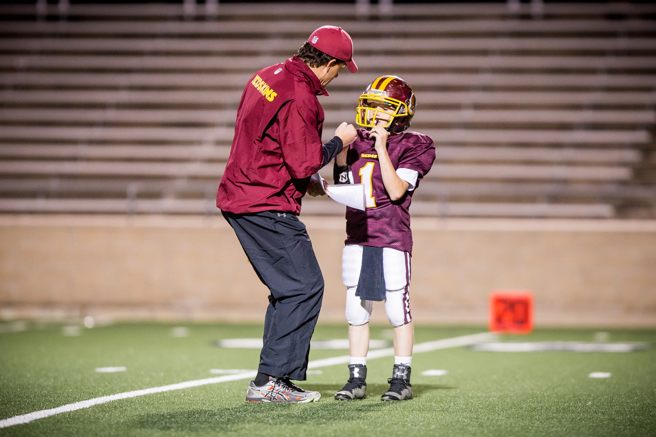 Coach Baay passionately shares the game play with QB Dillon