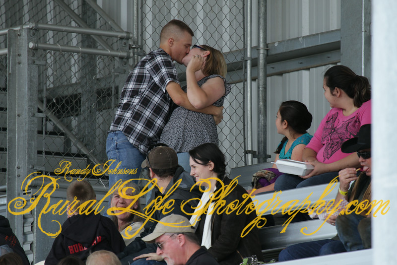 Marriage proposal at Tillamook Rodeo.This Gentlemen just asked his lady if she would merry him,and judging from her reaction I think she said yes.