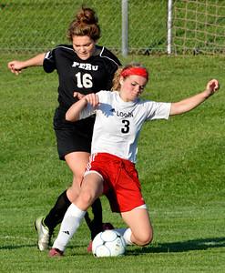 Logansport (IN) High School's Emily Pomasl battles Peru's Sydney Backus during their girl's soccer match Wednesday, Sept. 17, 2014. Logansport defeated Peru 5-1. (AP Photo/Logansport Pharos-Tribune, Steve Summers)