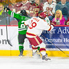 Pictured:  UND:  #27, Johnson, Luke, F, 6-0, 192, SO, Grand Forks, ND;  DU:  #39, Grant Arnold, F, 6-1, 215, JR, Centennial, CO