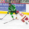 Pictured:  UND:  #15, Parks, Michael, F, 6-0, 198, SR, St. Louis, MO;  DU:  #26, Evan Janssen, F, 6-0, 185, SO, Green Bay, WI