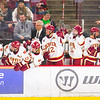 Players on the Pioneer bench celebrate a DU goal as some dufass Sioux fan with a moron grin wonders what the hell happened.