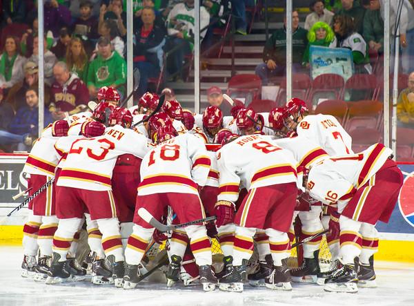 Pre-game DU player huddle.