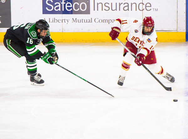 Pictured:  DU:  #11, Nolan Zajac, D, 5-10, 180, JR, Winnipeg, MAN;  UND:  #16, MacMillan, Mark, F, 6-0, 184, SR, Penticton, BC