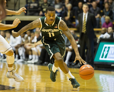Michigan State guard Keith Appling (11) drives against Purdue