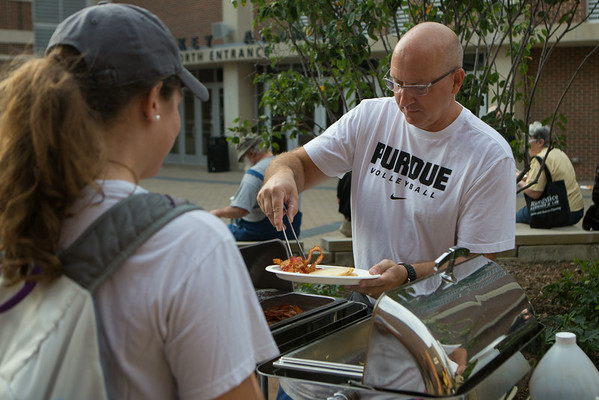 Purdue Volleball coach Dave Shondell serves breakfast to the fans before the morning matches of the Mortar Board Premier
