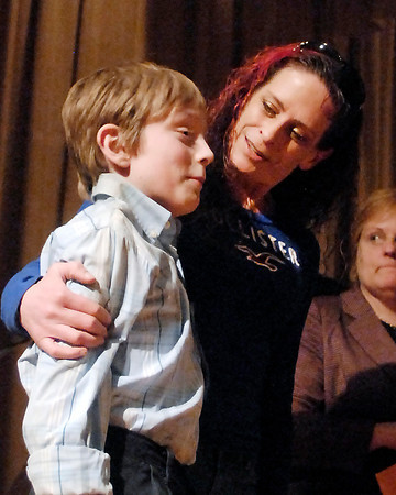 The 2014 THB Spelling Bee champ, Tristan Hankins of Highland Middle School, gets a hug from his mother, Whitney Knight, after his win Wednesday night.