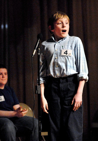 Tristan Hankins, of Highland Middle School, reacts to becoming the Spelling Bee champion after spelling the winning word 'malformed' as  runnerup Jeffery Krieg, of St. Mary Middle School in Anderson, applauds him.