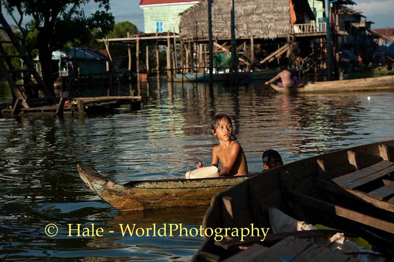 Young Villager In Her Boat