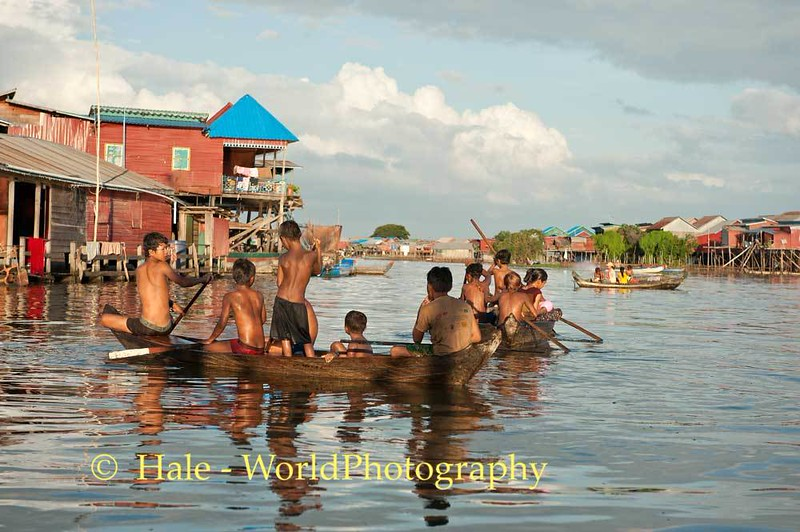Young Boys Paddling On Flooded Street of Kampong Khleang, Cambodia