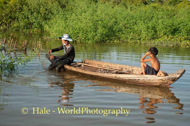 Boys Fishing On Tonle Sap Lake