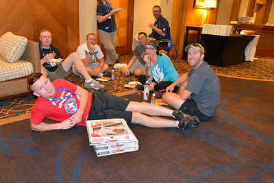 Participants eat pizza donated by Papa John's Pizza during the 2014 Ride 2 Recovery Memorial Challenge. As a 501(c)(3) organization, R2R helps injured active duty service members and veterans improve their health and wellness through individual and group cycling.