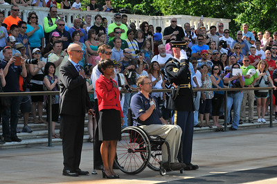 Participants attend a wreath laying ceremony at the Tomb of the Unknown Solder at the National Arlington Cemetery during the 2014 Ride 2 Recovery Memorial Challenge. As a 501(c)(3) organization, R2R helps injured active duty service members and veterans improve their health and wellness through individual and group cycling.