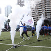 2014 NFL University Bowl VI - Day 2 - Guangzhou Sport University flag players take the field at the 2014 NFL University Bowl VI Championship.