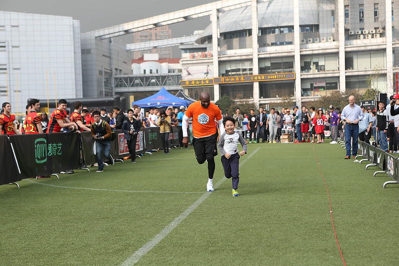 2014 NFL University Bowl VI - Day 1 - On November 22 & 23 Jerry Rice made an appearance at 2014 University Bowl VI (UBVI) in Shanghai. At UBVI, Jerry Rice taught some of the UrGAMES guest football fundamentals.