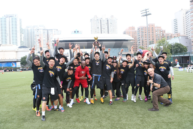 2014 NFL University Bowl VI - Day 2 - Jerry Rice and Richard Young, NFL China Managing Director, pose with Beijing Sports University after they defeat Guangzhou Sport University for the title of the 2014 University Bowl IV Champions.