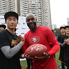 2014 NFL University Bowl VI - Day 2 - The winners of the 2014 NFL University Bowl VI, Beijing Sports University, pose with their game ball autographed by Jerry Rice.