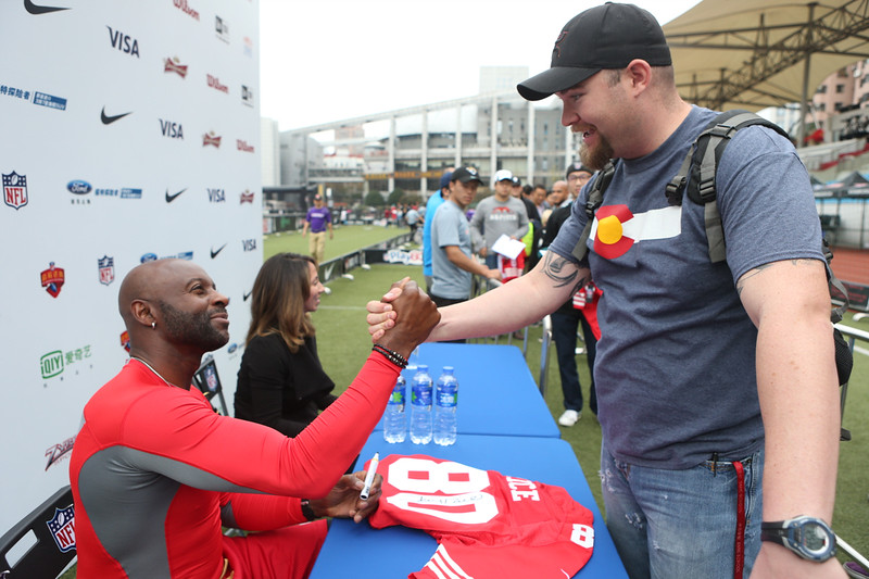 2014 NFL University Bowl VI - Day 2 - Jerry Rice held an autograph session from 1-2PM before the Championship game for fans at the 2014 NFL University Bowl in Shanghai.