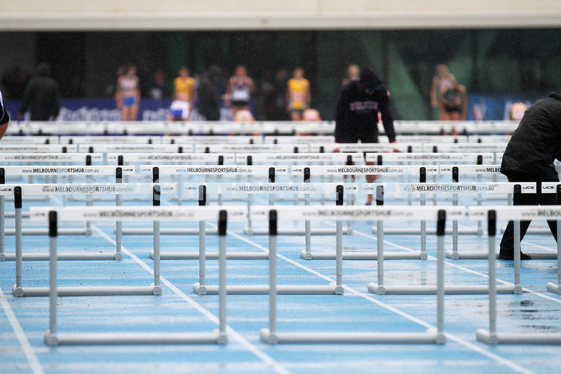16-2-14. Victorian Junior Athletics Championships. Lakeside Stadium. A wet start to the Sunday events. Photo: Peter Haskin