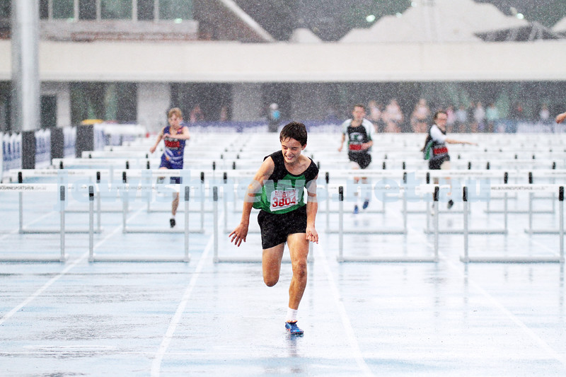 16-2-14. Victorian Junior Athletics Championships. Lakeside Stadium. A very wet start to the sunday events. Men U 14 90m hurdles. Photo: Peter Haskin
