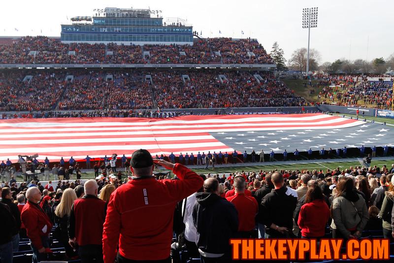 A Cincinnati fan salutes the flag during the national anthem. (Mark Umansky/TheKeyPlay.com)