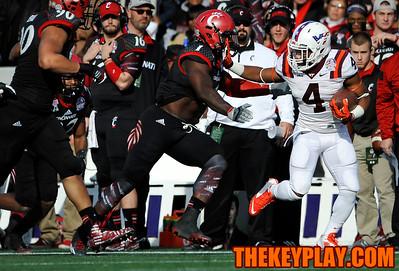 Virginia Tech Hokies running back J.C. Coleman stiff arms Cincinnati Bearcats linebacker Jeff Luc (1) as he breaks a big run down the sideline. (Michael Shroyer/TheKeyPlay.com)