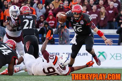 Backup QB Michael Colosimo jumps over a reaching Dadi Nicolas late in the 4th quarter. (Mark Umansky/TheKeyPlay.com)