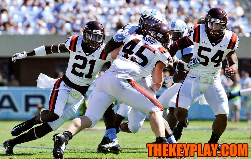 North Carolina Tar Heels running back T.J. Logan (8) is tackled by Virginia Tech Hokies full back Sam Rogers (45) on a kick off return. (Michael Shroyer/ Thekeyplay.com)