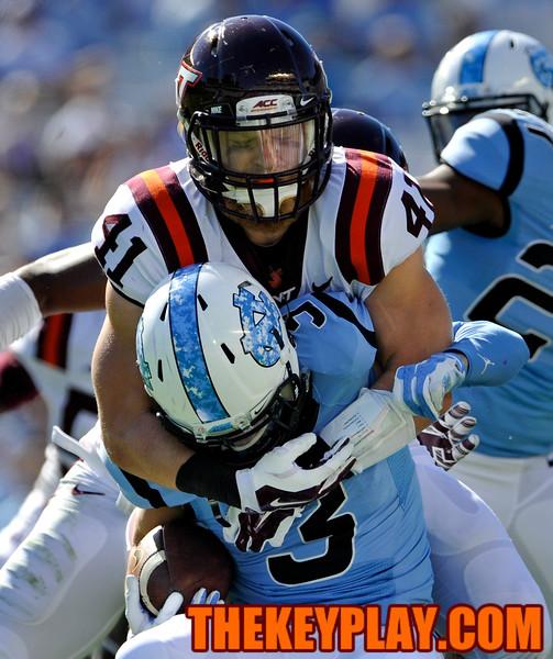 Virginia Tech Hokies outside linebacker Derek Di Nardo (41) hits North Carolina Tar Heels wide receiver Ryan Switzer (3) immediately after fielding the punt. (Michael Shroyer/ Thekeyplay.com)