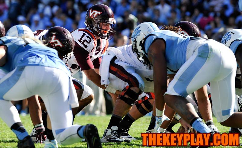 Virginia Tech Hokies quarterback Michael Brewer (12) yells the snap count before taking the snap inside the 5 yard line. (Michael Shroyer/ Thekeyplay.com)