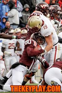 Demetri Knowles (80) gets hit hard on a kick return by Boston College's Sean Sylvia (19). (Mark Umansky/Thekeyplay.com)