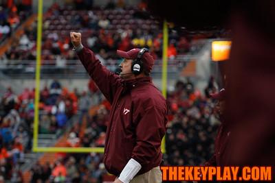 Defensive coordinator Bud Foster signals to his players. (Mark Umansky/Thekeyplay.com)
