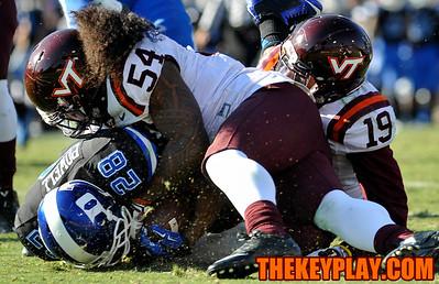 Virginia Tech linebacker Andrew Motuapuaka (54) tackles Duke running back Shaquille Powell (28). (Michael Shroyer/ Thekeyplay.com)