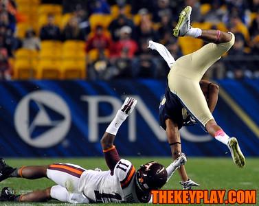 Virginia Tech Hokies cornerback Kendall Fuller (11) tackles and sends Pittsburgh Panthers running back Rachid Ibrahim (29) airborne. (Michael Shroyer/ Thekeyplay.com)