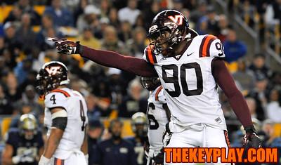 Virginia Tech Hokies defensive end Dadi Nicolas (90) points to Pittsburgh Panthers quarterback Chad Voytik (16) on the play following his big hit. (Michael Shroyer/ Thekeyplay.com)