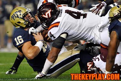 Virginia Tech Hokies defensive end Ken Ekanem (4) hits Pittsburgh Panthers quarterback Chad Voytik (16) early in the game. (Michael Shroyer/ Thekeyplay.com)
