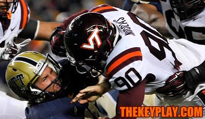 Virginia Tech Hokies defensive end Dadi Nicolas (90) hits Pittsburgh Panthers quarterback Chad Voytik (16) hard in the second quarter. (Michael Shroyer/ Thekeyplay.com)