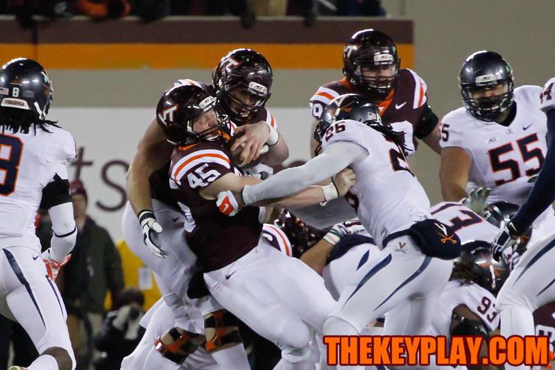 Sam Rogers (45) fights off a UVa tackle. (Mark Umansky/TheKeyPlay.com)